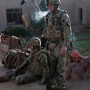 Cpl Chris Morrison (right) and Cpl John Goode (Medic) soldiers from B Coy 3 Scots and 1PWRR prepare to leave a compound during Operation Tora Pishaw 5 aimed at disrupting insurgent activity in their AO (Area of Operations.  Minutes later as they searched a nearby compound an IED exploded severely wounding Pte Stephen Bainbridge  who lost both legs as a result of the blast. Loya Manda, Nad e Ali North, Helmand Province, Afghanistan on the 11th of November 2011.
