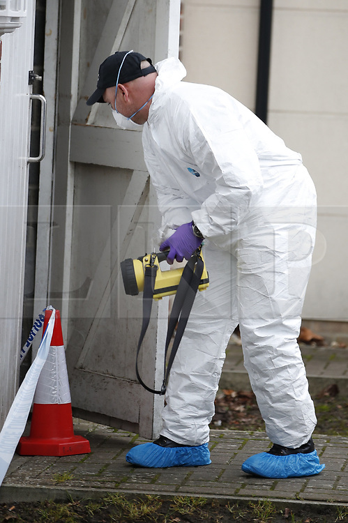 © Licensed to London News Pictures. 05/01/2019. Farnham, UK. Police forensics officers search a property after a couple were arrested in connection with the murder of a man on a train yesterday. A murder investigation has been launched after the man was attacked while on board the 12. 58pm train service travelling between Guildford and London Waterloo. A man and a woman have been detained by police in Farnham in connection with the murder. Photo credit: Peter Macdiarmid/LNP