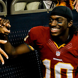 September 9, 2012; New Orleans, LA, USA; Washington Redskins quarterback Robert Griffin III (10) celebrate with fans following a win over the New Orleans Saints at the Mercedes-Benz Superdome. The Redskins defeated the Saints 40-32. Mandatory Credit: Derick E. Hingle-US PRESSWIRE
