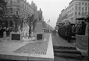 16/04/1966<br /> 04/16/1966<br /> 16 April 1966<br /> Unveiling of Thomas Davis Memorial at College Green, Dublin. The design by Irish sculptor Edward Delaney took the form of a statue fronted by a futuristic fountain on a cobblestone plinth. Picture shows the distinguished gathering viewing the monument after unveiling while the (Garda ?) band plays on the left.