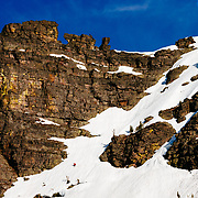 David Steele skis a line near the Hole in the Wall of Glacier National Park.