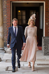Guy Pelly and his wife Lizzy arriving for the christening of Prince Louis, the youngest son of the Duke and Duchess of Cambridge at the Chapel Royal, St James's Palace, London.