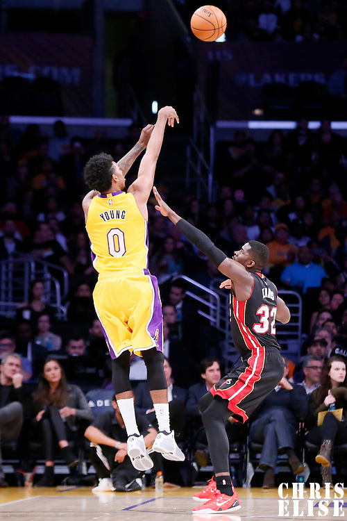 13 January 2014: Los Angeles Lakers forward Nick Young (0) takes a jump shot over Miami Heat forward James Ennis (32) during the Miami Heat 78-75 victory over the Los Angeles Lakers, at the Staples Center, Los Angeles, California, USA.