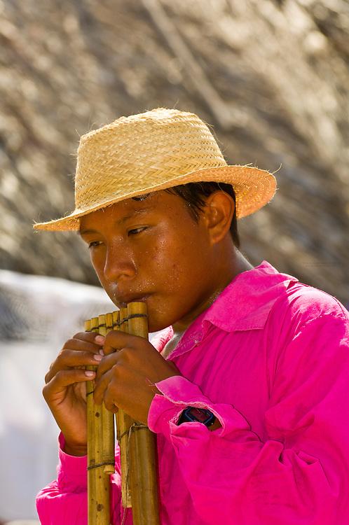 Kuna Indian man playing flute, cultural performance,  Wichub Wala Island, San Blas Islands (Kuna Yala), Caribbean Sea, Panama