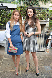 Left to right, IRENE FORTE and SHIRLEY LEIGH WOOD-OAKES at a party to celebrate 'A Year In The Garden' celebrating the first year of The Ivy Chelsea Garden, 197 King's Road, London on 16th May 2016.