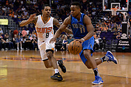 Apr 9, 2017; Phoenix, AZ, USA; Dallas Mavericks guard Yogi Ferrell (11) handles the ball against Phoenix Suns guard Tyler Ulis (8) in the first half of the NBA game at Talking Stick Resort Arena. Mandatory Credit: Jennifer Stewart-USA TODAY Sports