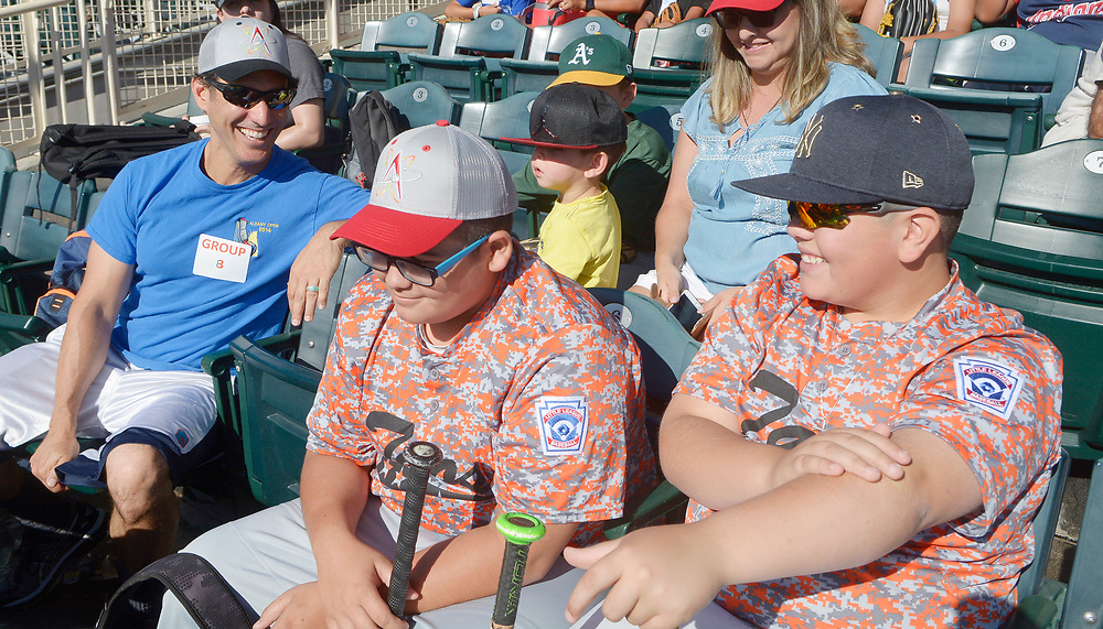 gbs072917i/SPORTS -- Pat Newell, Albuquerque Journal Sports Stringer, talks with Taos Little Leaguers Lucas Montoya, 12, and A.J. Abeyta, 12, from left, during the Isotopes Youth Skills Clinic on Saturday, July 29, 2017. (Greg Sorber/Albuquerque Journal)