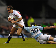 Twickenham. GREAT BRITAIN, Filipe CONTPOMI, reaches out to get a grip on Charlie HODGSON, during the, 2006 Investec Challenge, game between, England  and Argentina, on Sat., 11/11/2006, played at the Twickenham Stadium, England. Photo, Peter Spurrier/Intersport-images].....