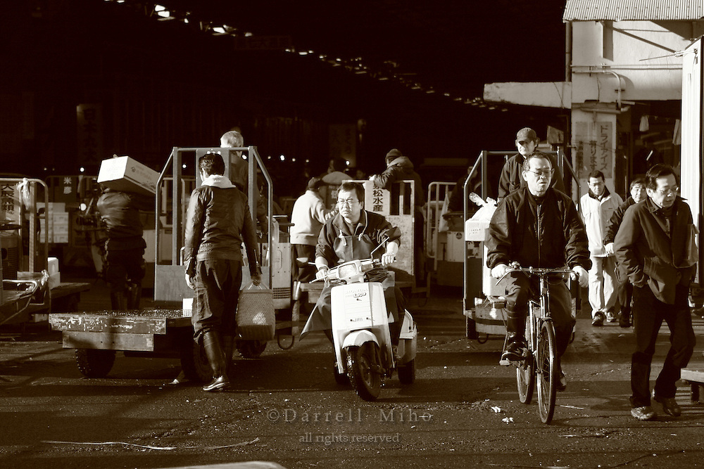 Mar 4, 2006; Tokyo, JPN; Tsukiji.Workers get around on foot, scooters, bikes and  motorized carts at the Tsukiji Fish Market...Photo credit: Darrell Miho