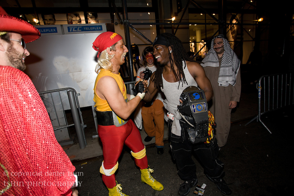 Halloween partiers costumed as WWF wrestling characters