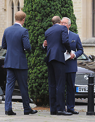 © Licensed to London News Pictures. 11/09/2013<br /> Prince of Wales getting a kiss from Prince William<br /> Leaving the Cathedral after the Mass.<br /> Funeral for Hugh Van Cutsem at Brentwood Cathedral,Essex.<br /> Prince of Wales,Duke of Cambridge and Prince Harry in attendance today (11.09.2013)<br /> Photo credit :Grant Falvey/LNP