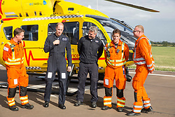 July 27, 2017 - Cambridge, United Kingdom - Image licensed to i-Images Picture Agency. 27/07/2017. Cambridge, United Kingdom. Prince William on his last day at East Anglia Air Rescue at Cambridge Airport, United Kingdom. With the rest of his crew: Dr Adam Chesters,  Cpt Dave Kelly, Dr Tobias Gouse and CCP Carl Smith .  Picture by ROTA / i-Images (Credit Image: © Rota/i-Images via ZUMA Press)