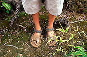 Child's muddy sandals after hiking the Pihea Trail, Kokee State Park, Kauai, Hawaii USA