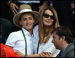 Image ©Licensed to i-Images Picture Agency. 03/07/2014. London, United Kingdom. Julie Leclair and and her son William Bouchard in the players box as the Eugenie Bouchard family celebrate in players box after Eugenie Bouchard beats Simona Halep in the ladies' Semi Final at Wimbledon. Picture by Andrew Parsons / i-Images
