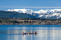 Dragonboater's paddle with the majestic backdrop of the Comox Glacier and Beaufort Mountains in the Comox Valley.  Courtenay, The Comox Valley, Vancouver Island, British Columbia, Canada.
