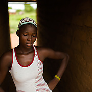 Umuliara (approximately 18), pictured in the Upper West Region of Ghana on 27 May 2014, completed primary school, but was unable to continue her education because there is no high school in her community. The nearest Junior High School is an 18-kilometre walk away, at the end of a track that becomes impassable during the rainy season.