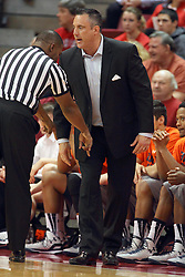 17 December 2014:  Referee Winston Stith reminds coach Heath Schroyer where he should stand during an NCAA Men's Basketball game between the Skyhawks of University of Tennessee - Martin and the Redbirds of Illinois State at Redbird Arena in Normal Illinois