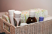 A basket with baby care lotions and creams