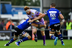 Jannes Kirsten of Exeter Chiefs is tackled by Rhys Davies of Bath Rugby - Mandatory by-line: Ryan Hiscott/JMP - 21/09/2019 - RUGBY - Sandy Park - Exeter, England - Exeter Chiefs v Bath Rugby - Premiership Rugby Cup