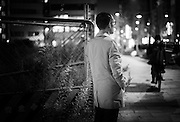 Satoru Tanaka (pseudonym) walks through a central district of Tokyo, Japan on Dec. 01, 2016.  ROB GILHOOLY PHOTO