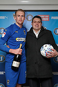 AFC Wimbledon midfielder Mitchell (Mitch) Pinnock (11) receiving man of match award during the EFL Sky Bet League 1 match between AFC Wimbledon and Burton Albion at the Cherry Red Records Stadium, Kingston, England on 28 January 2020.