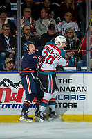 KELOWNA, CANADA - DECEMBER 27: Luke Zazula #7 of the Kamloops Blazers is checked into the boards by Conner Bruggen-Cate #20 of the Kelowna Rockets on December 27, 2017 at Prospera Place in Kelowna, British Columbia, Canada.  (Photo by Marissa Baecker/Shoot the Breeze)  *** Local Caption ***
