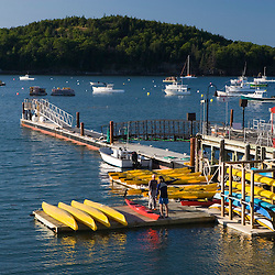 Sea kayaks on the municipal pier in Bar Harbor Maine USA