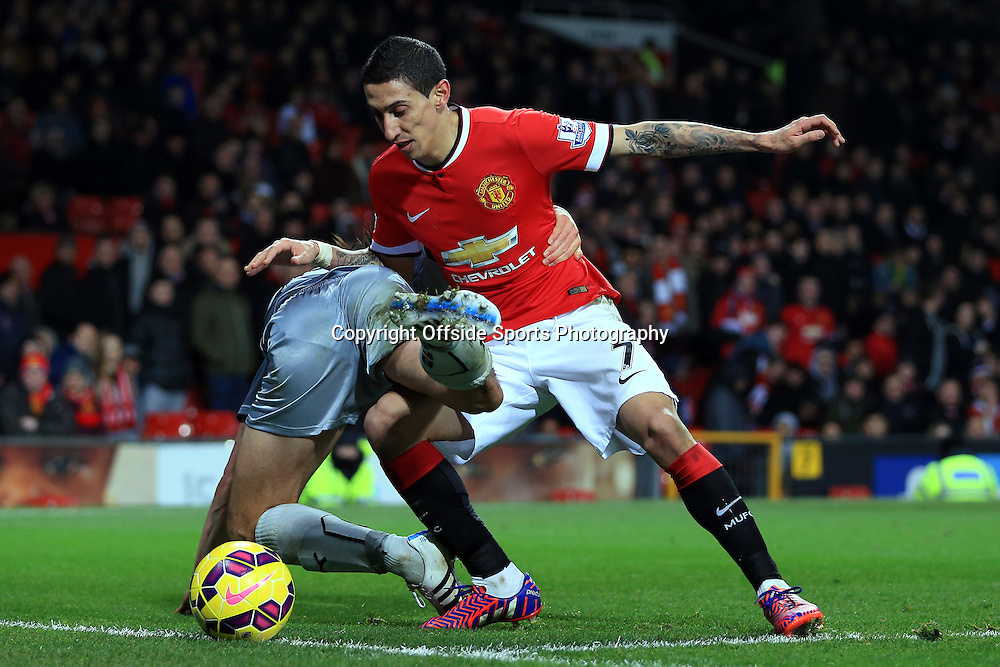 11th February 2015 - Barclays Premier League - Manchester United v Burnley - Angel Di Maria of Man Utd battles with George Boyd of Burnley - Photo: Simon Stacpoole / Offside.