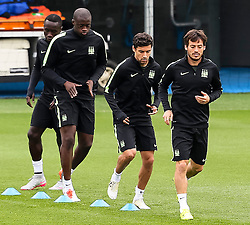 Bacary Sagna, Yaya Toure, Jesus Navas and David Silva of Manchester City during the training session at the Etihad Stadium ahead of the UEFA Champions League group D match against Juventus - Mandatory byline: Matt McNulty/JMP - 07966386802 - 14/09/2015 - FOOTBALL - Etihad Stadium -Manchester,England - UEFA Champions League