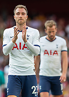 Football - 2019 / 2020 Premier League - Arsenal vs. Tottenham Hotspur<br /> <br /> A tearful Christian Eriksen (Tottenham FC)  applauds the fans at the end of the game in what could be his last match for Tottenham at The Emirates.<br /> <br /> COLORSPORT/DANIEL BEARHAM