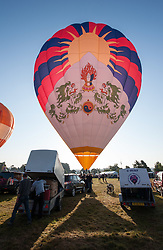 © Licensed to London News Pictures. 08/08/2015. Bristol, UK. Day 3 of the Bristol International Balloon Fiesta 2015.  The Tibet balloon which is probably the largest Tibetan flag in the world.  The balloon has attracted some controversy as Chinese embassy officials have made several attempts to have the balloon grounded, by asking balloon festival organisers in Spain, France and the UK to cancel the balloon's entry to festivals.  The Bristol International Balloon Fiesta have refused to ban the Tibet balloon.  Photo credit : Simon Chapman/LNP