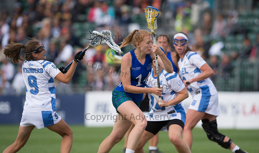 Scotland's Jenni Aiton goes past the Israel defence to score during their classification game at the 2017 FIL Rathbones Women's Lacrosse World Cup, at Surrey Sports Park, Guildford, Surrey, UK, 21st July 2017.