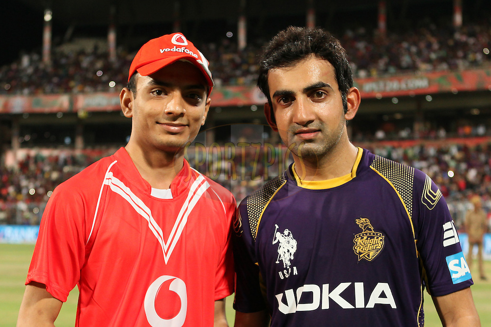 KKR captain Gautam Gambhir(R) with Vodafone ball winner during the first qualifier match (QF1) of the Pepsi Indian Premier League Season 2014 between the Kings XI Punjab and the Kolkata Knight Riders held at the Eden Gardens Cricket Stadium, Kolkata, India on the 28th May  2014<br /> <br /> Photo by Saikat Das / IPL / SPORTZPICS<br /> <br /> <br /> <br /> Image use subject to terms and conditions which can be found here:  http://sportzpics.photoshelter.com/gallery/Pepsi-IPL-Image-terms-and-conditions/G00004VW1IVJ.gB0/C0000TScjhBM6ikg