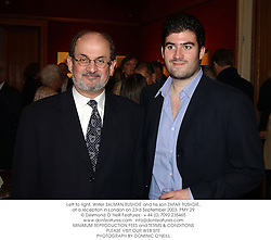 Left to right, Writer SALMAN RUSHDIE and his son ZAFAR RUSHDIE, at a reception in London on 23rd September 2003.PMY 29