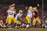 12 January 2013: Quarterback (12) Aaron Rogers of the Green Bay Packers scrambles away from defenders of the San Francisco 49ers during the first half of the 49ers 45-31 victory over the Packers in an NFL Divisional Playoff Game at Candlestick Park in San Francisco, CA.