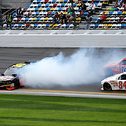 Ryan Sieg (39), driving the Pull-A-Part Chevrolet, spins on the front stretch during the NASCAR DRIVE4COPD 300 auto race at Daytona International Speedway on Saturday, February 22, 2014 in Daytona Beach, Florida.  (AP Photo/Alex Menendez)