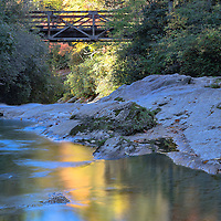 Fall foliage and the Iron Bridge along the Chattooga River, near Highlands, North Carolina