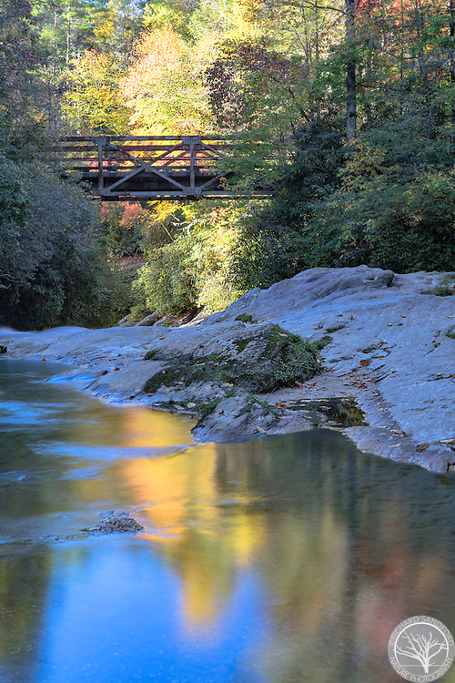 Fall foliage and the Iron Bridge along the Chattooga River, near Highlands, North Carolina