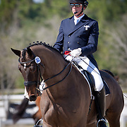 John P McGinty Jr and Playboy during the 2013 Wellington Classic Dressage Sunshine Challenge at the Jim Brandon Equestrian Center in West Palm Beach, Florida.