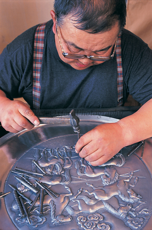Silver smith at work<br /> Artist's Union<br /> Ulaanbaatar<br /> Mongolia