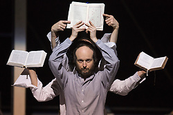 "© Licensed to London News Pictures. 24/01/2014. London, England. Pictured: Sidi Larbi Cherkaoui dancing with religious books such as the Koran and the Bible. Belgian dancer/choreographer Sidi Larbi Cherkaoui's work ""Apocrifu"" uses the language of the body to explore apocryphal religious texts, accompanied by the polyphonic singing from the all-male Corsican vocal ensemble ""A Filetta"". Dancers: Sidi Larbi Cherkaoui, Dimitri Jourde and Yasuyuki Shuto. Performances at the Queen Elizabeth Hall, Southbank Centre from 24th to 25the January 2014. Photo credit: Bettina Strenske/LNP"