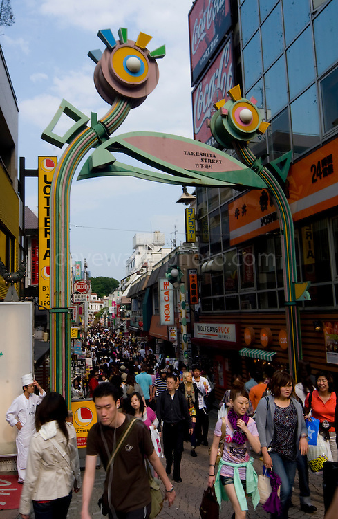 """Saturday shoppers in on Takeshita Street, Harajuku. Harajuku is reknowned for its outrageous youth fashions and """"bo beep"""" girls. Editorial Only.."""