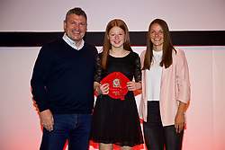 NEWPORT, WALES - Saturday, May 19, 2018: Katue Hoare is presented with her Under-16's cap by Osian Roberts (left) and Lauren Dykes (right) during the Football Association of Wales Under-16's Caps Presentation at the Celtic Manor Resort. (Pic by David Rawcliffe/Propaganda)