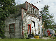 An abandoned gas station stands as a remnant from the past in Claremont, South Dakota.  In decades past, it was a meeting point for men in the town.