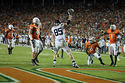 Virginia tight end John M. Phillips (85) celebrates after catching a Virginia quarterback Jameel Sewell (10) pass on the 1 yard line.  The #19 Virginia Cavaliers defeated the Miami Hurricanes 48-0 at the Orange Bowl in Miami, Florida on November 10, 2007.  The game was the final game played in the Orange Bowl.