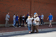 CHICAGO, IL - MAY 18: A panhandler in a bear costume solicits tips outside the stadium before the game between the Chicago Cubs and New York Mets on May 18, 2013 at Wrigley Field in Chicago, Illinois. The Cubs won 8-2. (Photo by Joe Robbins)