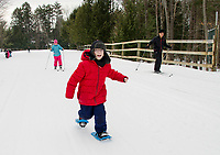 "When I asked William about his first snowshoeing experience his response was ""all it takes is determination"".  Mrs. Besegai and Mrs. Morin's 5th grade class from Elm Street School spend Thursday morning at Bolduc Park to try snowshoeing, cross country skiing and skating as part of learning about winter Olympics sports.  (Karen Bobotas/for the Laconia Daily Sun)"