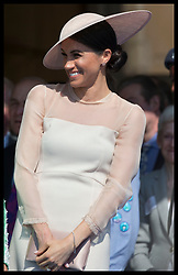 May 22, 2018 - London, London, United Kingdom - Image licensed to i-Images Picture Agency. 22/05/2018. London, United Kingdom. The Duchess of Sussex gets the giggles during a speech by her husband the Duke of sussex at the Prince of Wales' 70th Birthday Patronage Celebration in the gardens of  Buckingham Palace in London. (Credit Image: © Stephen Lock/i-Images via ZUMA Press)