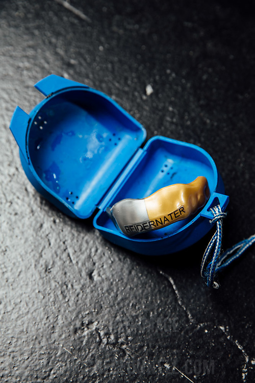 Mixed Martial Arts Fighter Alex Reid's gum shield, embelished with his fighting alter-ego 'The Rediernater'. UK, 27th October 2014. Photo by Greg Funnell.