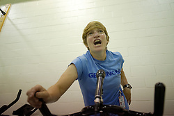 Erica Tibbetts leads a spinning class for incarcerated women as part of the Gearing-Up program.